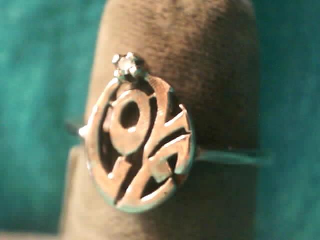 Lady's Diamond Fashion Ring .01 CT. 10K White Gold 1.3dwt
