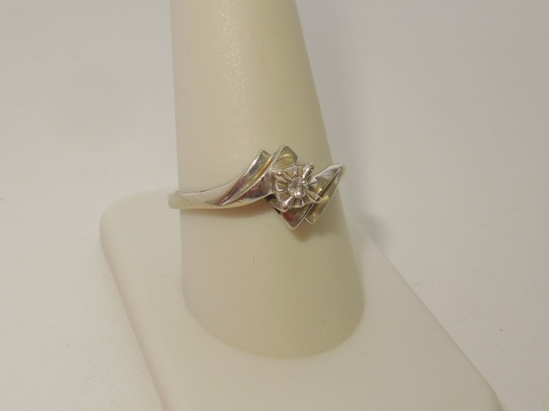 Lady's Diamond Solitaire Ring .02 CT. 10K White Gold 2.4g