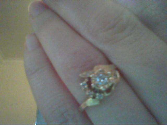 Lady's Diamond Fashion Ring 6 Diamonds .16 Carat T.W. 14K Yellow Gold 2.9g