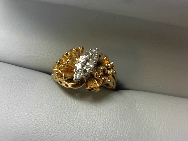 Lady's Diamond Fashion Ring 8 Diamonds .16 Carat T.W. 14K Yellow Gold 4.1g