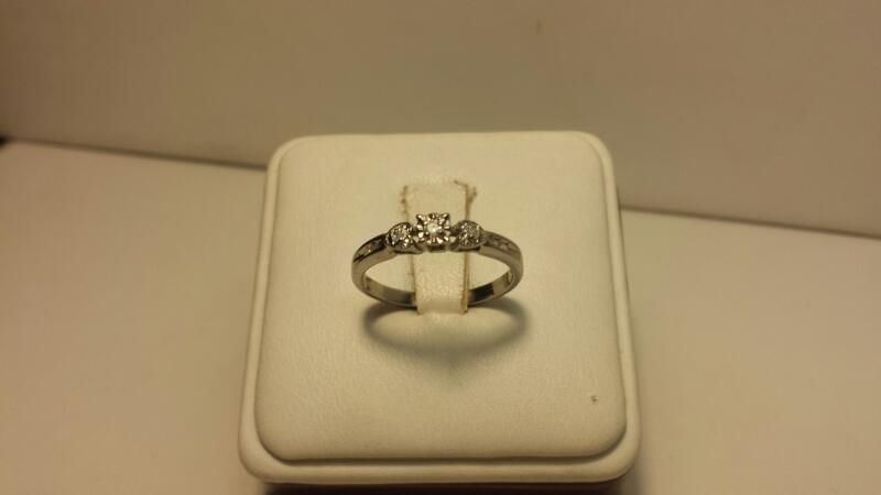 10k White Gold Ring with 7 Diamonds at .10CTW - 1.2DWT - Size 7