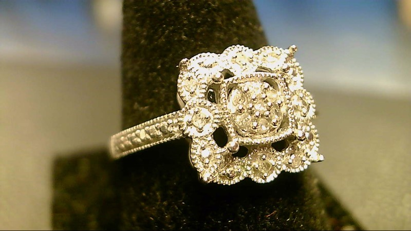 Lady's Diamond Cluster Ring 13 Diamonds .13 Carat T.W. 10K White Gold 2.5g