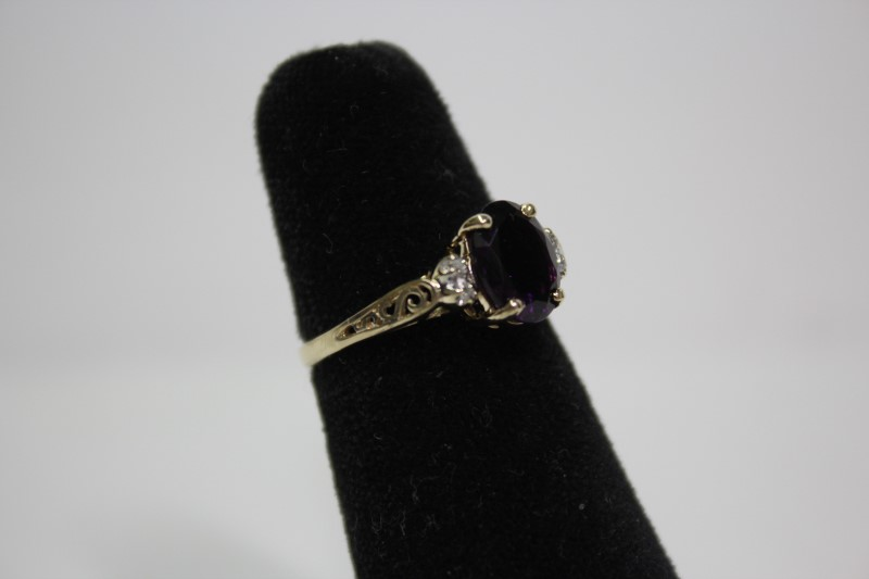 Lady's Purple Stone & Diamond Ring 4 Diamonds .04 Carat T.W. Size: 6.5