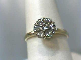 Lady's Diamond Cluster Ring 7 Diamonds .21 Carat T.W. 14K Yellow Gold 1.3dwt