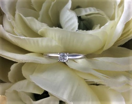 Lady's Diamond Solitaire Ring .18 CT. 14K White Gold 2.28g Size:6.8