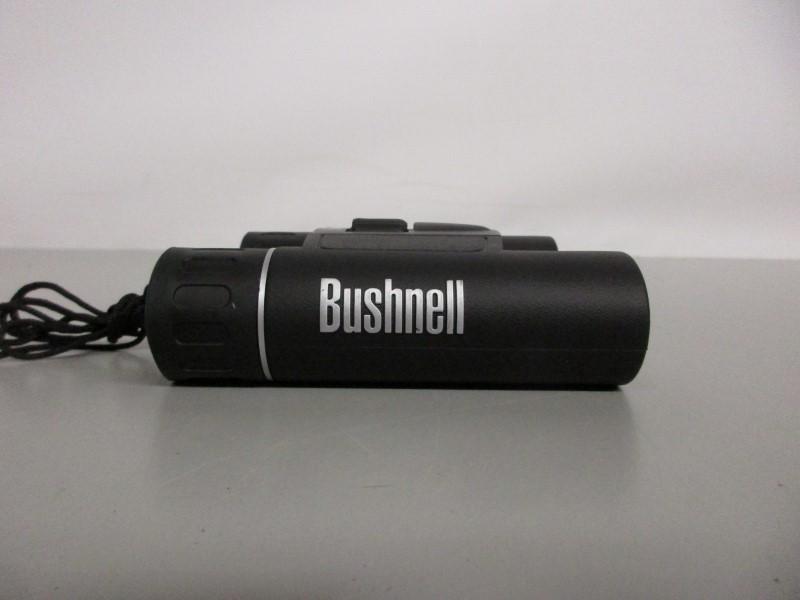 BUSHNELL 12X25 240FT at 1000 YDS BINOCULARS