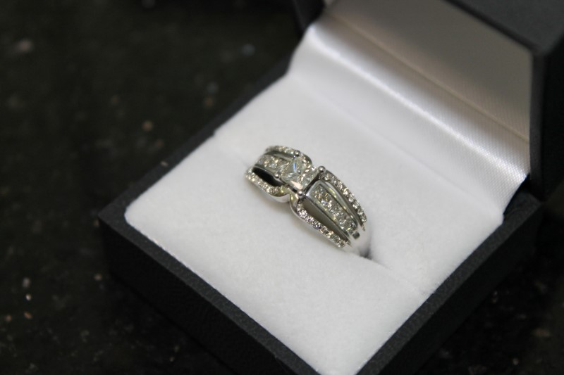 Lady's 14k white gold 1/2ct princess cut /princess cut and round diamond ring
