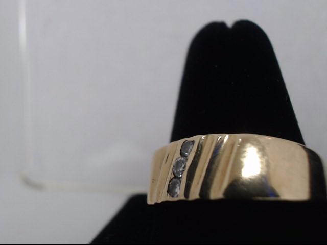 Lady's Diamond Wedding Band 3 Diamonds .09 Carat T.W. 14K Yellow Gold 2g