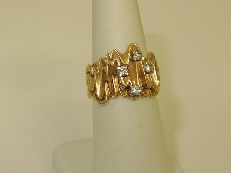 Lady's Diamond Fashion Ring 4 Diamonds .16 Carat T.W. 14K Yellow Gold 6.7g