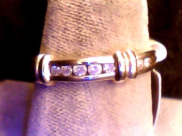 Lady's Diamond Wedding Band 9 Diamonds .13 Carat T.W. 10K Yellow Gold 1.7dwt