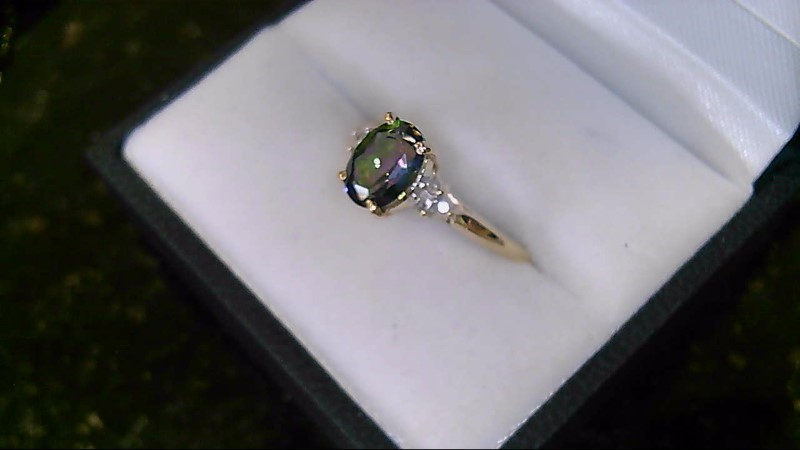 Lady's 10k yellow gold oval mystic topaz with dia accent ring