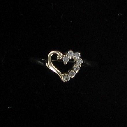 Lady's Diamond Fashion Ring 7 Diamonds .07 Carat T.W. 10K Yellow Gold 1dwt