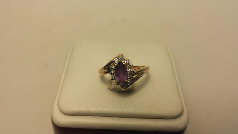10k Yellow Gold Ring with 1 Purple & 2 Clear Stones at .66CTW - 1.7DWT - Size 6