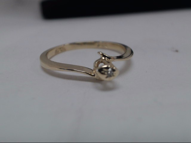 Lady's Diamond Solitaire Ring .03 CT. 10K Yellow Gold 1.3g