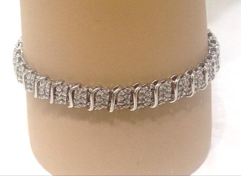 "7"" 10K White Gold Wave Inspired Round Diamond Cluster Tennis Bracelet"