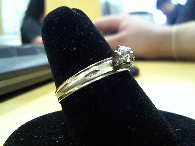 Lady's Diamond Solitaire Ring .05 CT. 10K Yellow Gold 2g