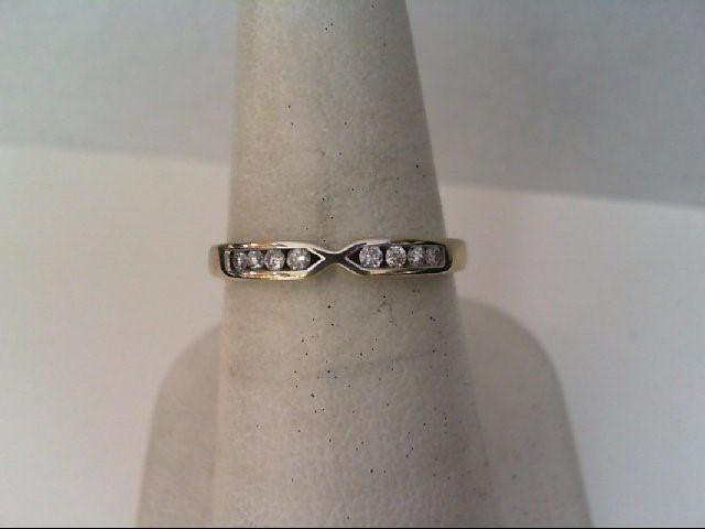 Lady's Diamond Wedding Band 8 Diamonds .16 Carat T.W. 10K White Gold 1.9g