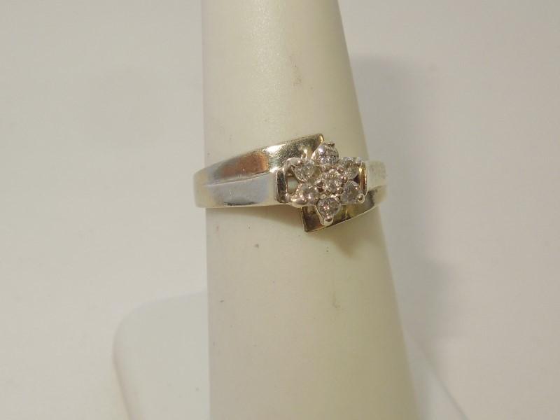 Lady's Diamond Fashion Ring 7 Diamonds .07 Carat T.W. 10K White Gold 2.4g