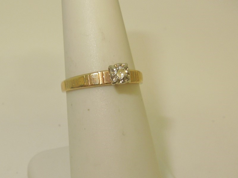 Lady's Diamond Solitaire Ring .07 CT. 10K Yellow Gold 1.8g