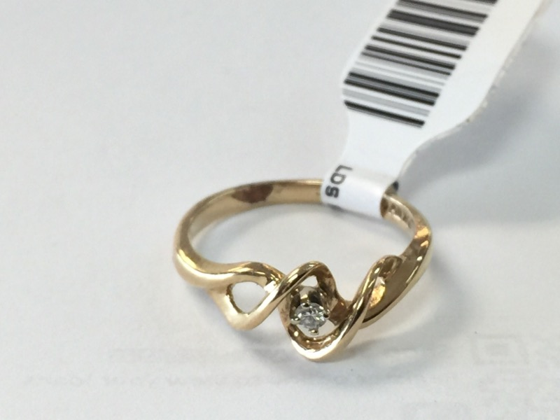 Lady's Diamond Fashion Ring .01 CT. 10K Yellow Gold 1.3dwt Size:6.8
