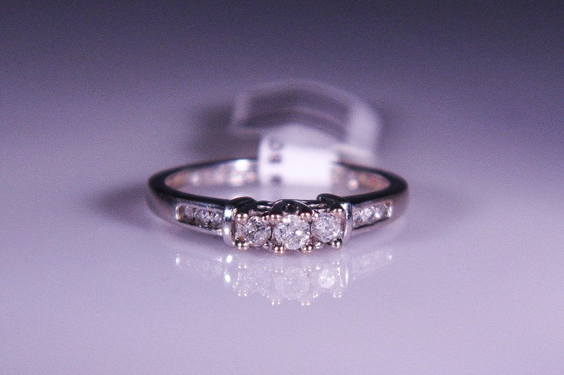 Lady's Gold-Diamond Anniversary Ring 9 Diamonds .22 Carat T.W. 10K White Gold
