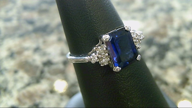 Blue Stone Lady's Stone & Diamond Ring 6 Diamonds .06 Carat T.W. 10K White Gold