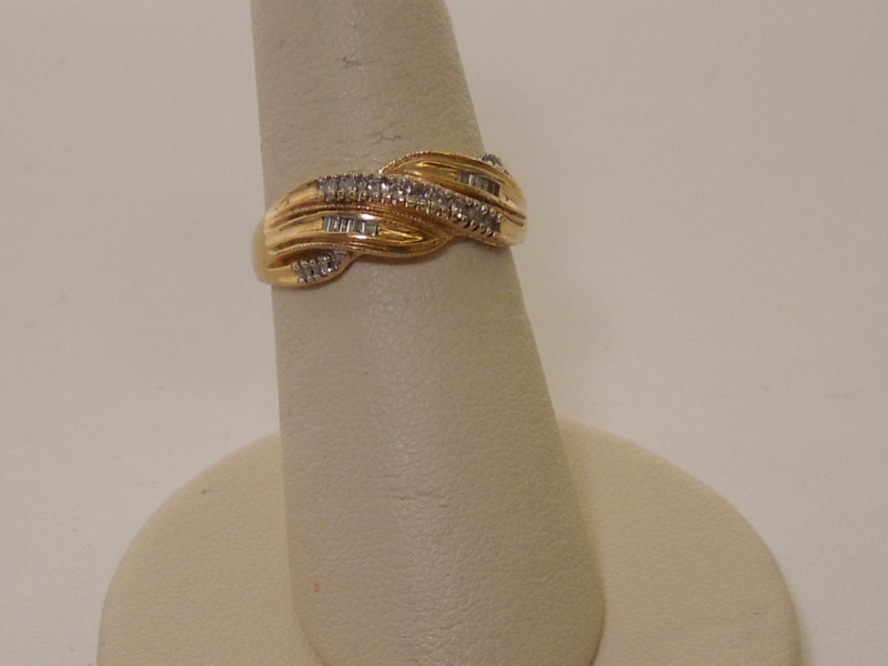 Lady's Diamond Fashion Ring 23 Diamonds .165 Carat T.W. 14K Yellow Gold 2.3g