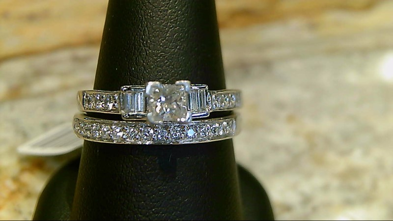 Lady's 14k white gold 1/4ct princess cut with 4-baugette and 21 rd dia wed set