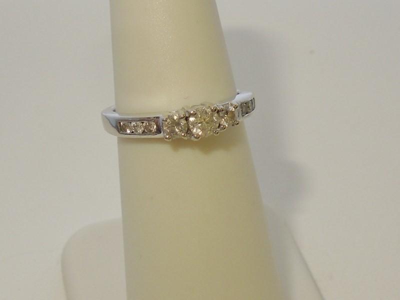 Lady's Diamond Fashion Ring 9 Diamonds .39 Carat T.W. 10K White Gold 2.3g