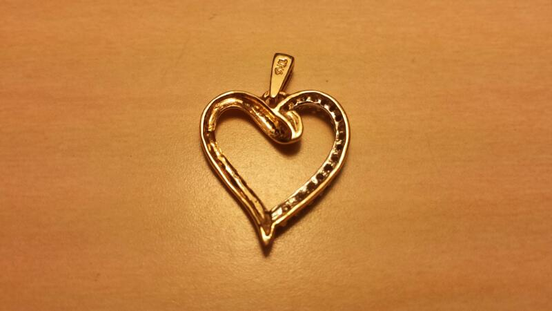 10k Yellow Gold Heart Pendant with 16 Diamond Chips