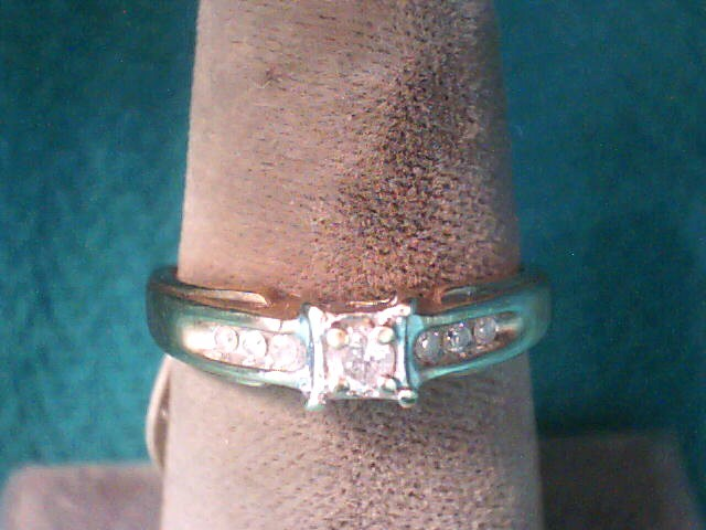 Lady's Diamond Solitaire Ring 7 Diamonds .12 Carat T.W. 10K Yellow Gold 1.5dwt