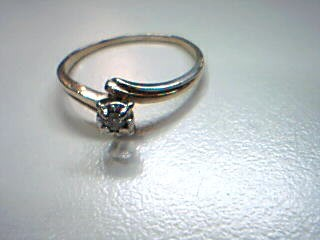 Lady's Diamond Solitaire Ring .07 CT. 10K Yellow Gold 1.5g Size:9