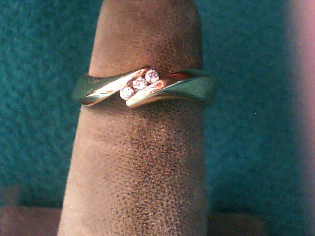 Lady's Diamond Fashion Ring 3 Diamonds .03 Carat T.W. 14K Yellow Gold 2.8dwt