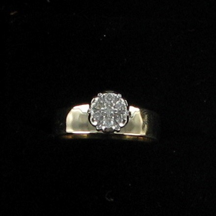 Lady's Diamond Cluster Ring 7 Diamonds .14 Carat T.W. 14K Yellow Gold 2.5dwt