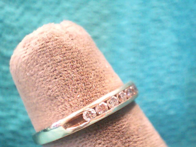Lady's Diamond Wedding Band 11 Diamonds .22 Carat T.W. 14K Yellow Gold 1.2dwt