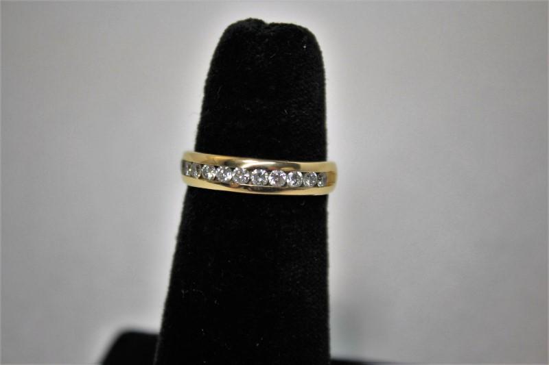Lady's Diamond Wedding Band 12 Diamonds .60 Carat T.W. 14K Yellow Gold 3.4g