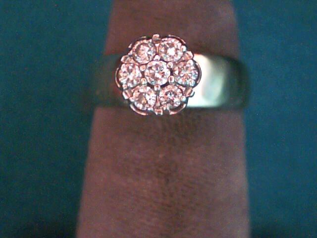 Lady's Diamond Cluster Ring 7 Diamonds .21 Carat T.W. 10K Yellow Gold 2.4dwt