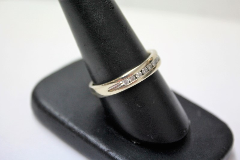 Gent's Gold-Diamond Wedding Band 8 Diamonds .24 Carat T.W. 10K White Gold 4.3g