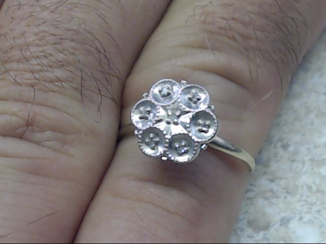 Lady's Diamond Cluster Ring 7 Diamonds .035 Carat T.W. 10K Yellow Gold 1.5g