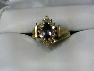 Synthetic Tanzanite Lady's Stone & Diamond Ring 16 Diamonds .16 Carat T.W.