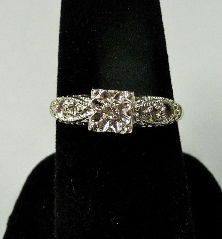 Lady's Diamond Fashion Ring .05 CT. 14K White Gold 1.76dwt