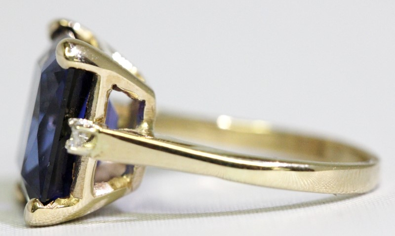 Tanzanite Lady's Stone & Diamond Ring 2 Diamonds .04 Carat T.W. 14K Yellow Gold