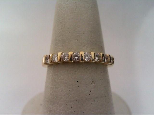Lady's Diamond Wedding Band 8 Diamonds .32 Carat T.W. 14K Yellow Gold 2.3g