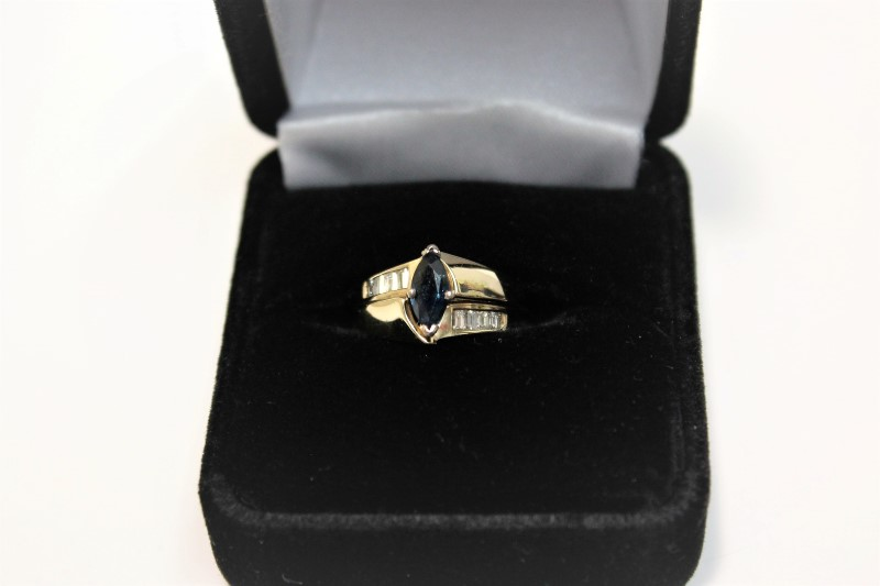 Blue Stone Lady's Stone & Diamond Ring 8 Diamonds .24 Carat T.W. Size: 4