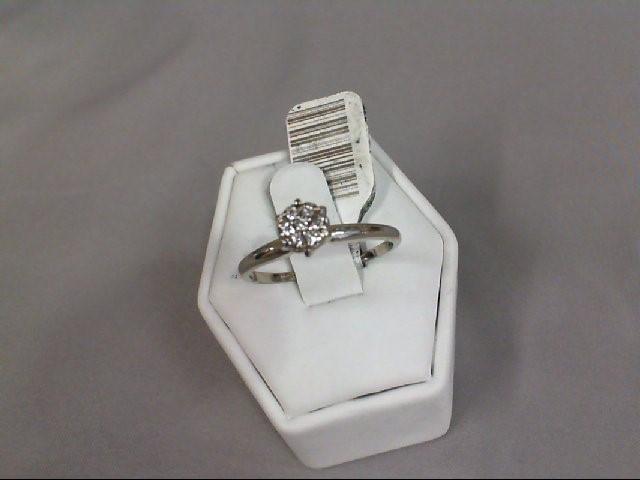 Lady's Diamond Cluster Ring 7 Diamonds .07 Carat T.W. 14K White Gold 2.34g