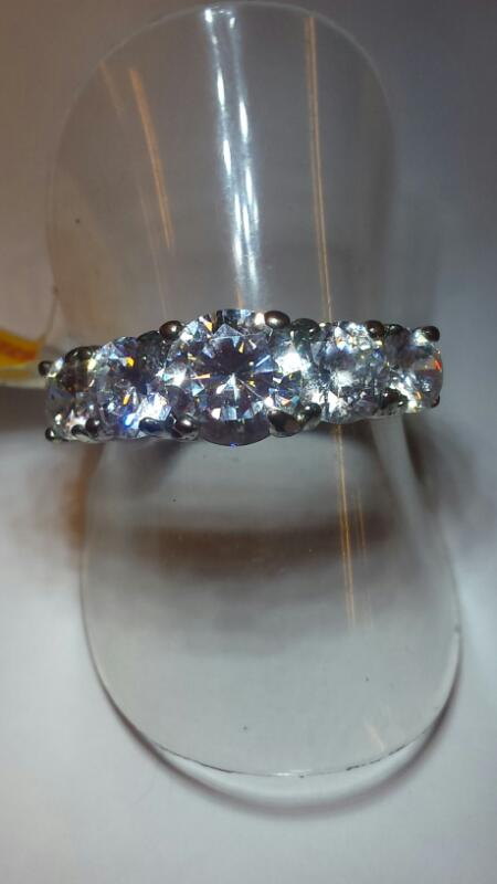 STERLING LG CZ WITH 2 ON EACH SIDE RING SIZE 6.5
