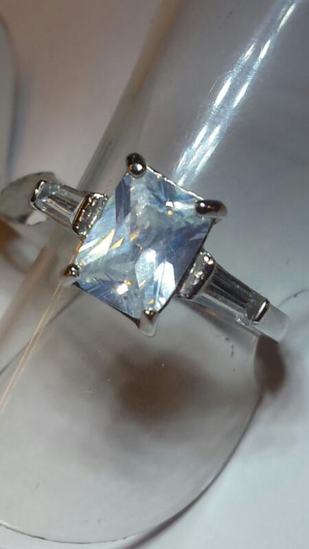 STERLING SILVER CZ EMERAL CUT WITH TWO BAGUETTS ON EITHER SIDE SIZE 6