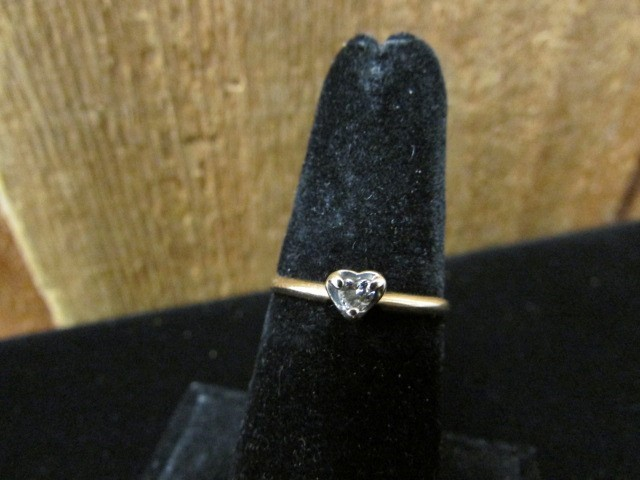 Lady's Diamond Solitaire Ring .10 CT. 14K Yellow Gold 1.2g Size:7