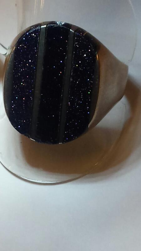 STERLING SILVER RING WITH 3 VERTICAL LINES OF BLACK GOLDSTONE SIZE: 11 1/2