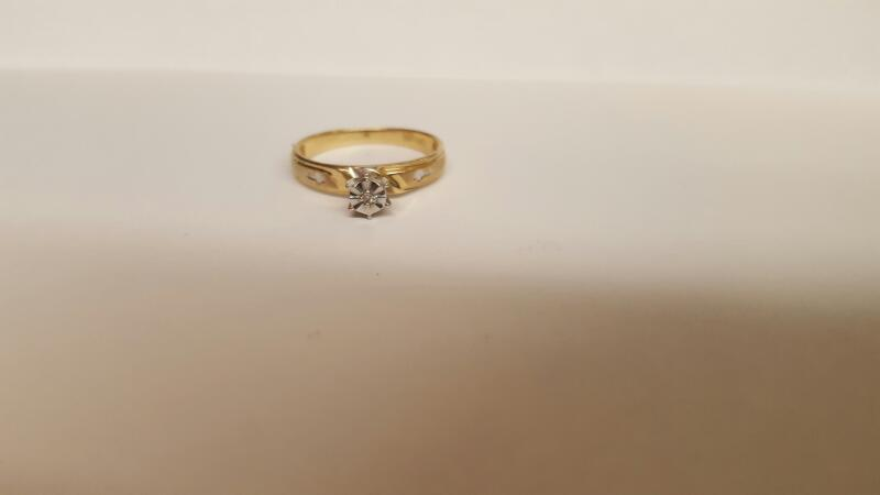 Lady's Diamond Solitaire Ring .02 CT. 10K Yellow Gold 1.82g Size:7
